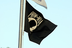 11 August 2012:  The POW-MIA flag flies during a Frontier League Baseball game between the River City Rascals and the Normal CornBelters at Corn Crib Stadium on the campus of Heartland Community College in Normal Illinois.  The CornBelters take this game in 9 innings 7 - 2 with a 5 run 2nd inning.