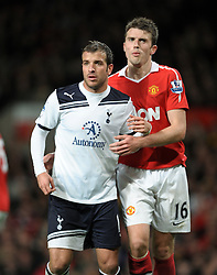Rafael Van Der Vaart and Michael Carrick Manchester United during the Barclays Premier League match between Manchester United and Tottenham Hotspur at Old Trafford on October 30, 2010 in Manchester, England.