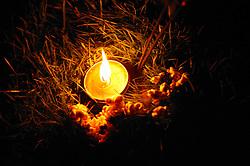 Candle burning to celebrate the Hindu Holi festival; celebration of colours,