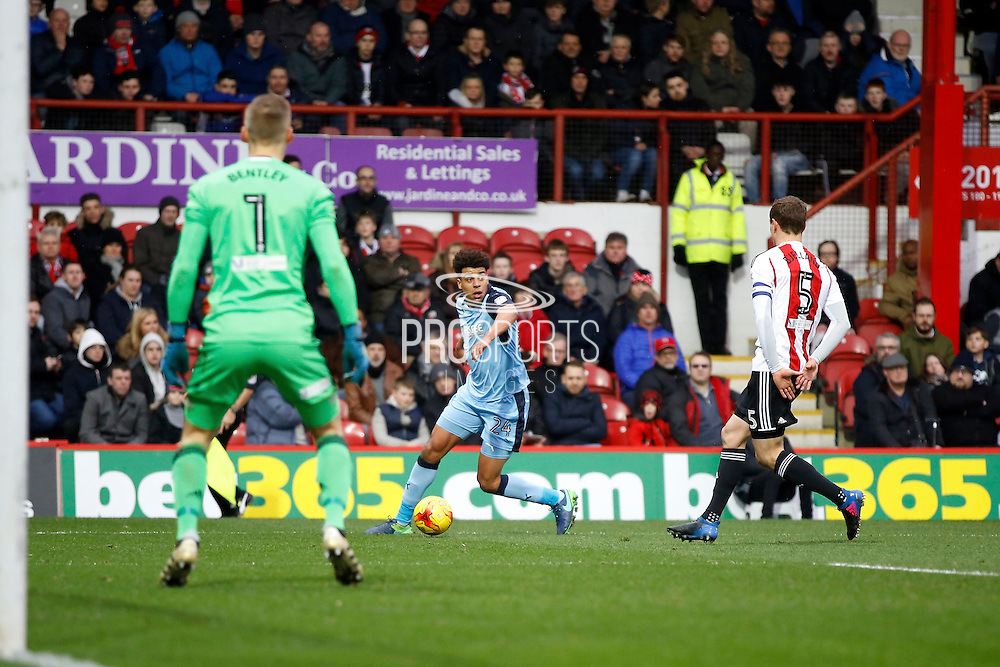 Rotherham United midfielder Tom Adeyemi (24) looks up to find a man in the box during the EFL Sky Bet Championship match between Brentford and Rotherham United at Griffin Park, London, England on 25 February 2017. Photo by Andy Walter.