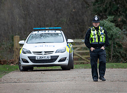 © Licensed to London News Pictures. 05/01/2019. Clandon, UK. Police guard a gate near West Clandon station in Surrey - where a man left the Waterloo bound train after a passenger was stabbed to death yesterday. A murder investigation has been launched after the man was attacked while on board the 12. 58pm train service travelling between Guildford and London Waterloo. A man and a woman have been detained by police in Farnham in connection with the murder. Photo credit: Peter Macdiarmid/LNP