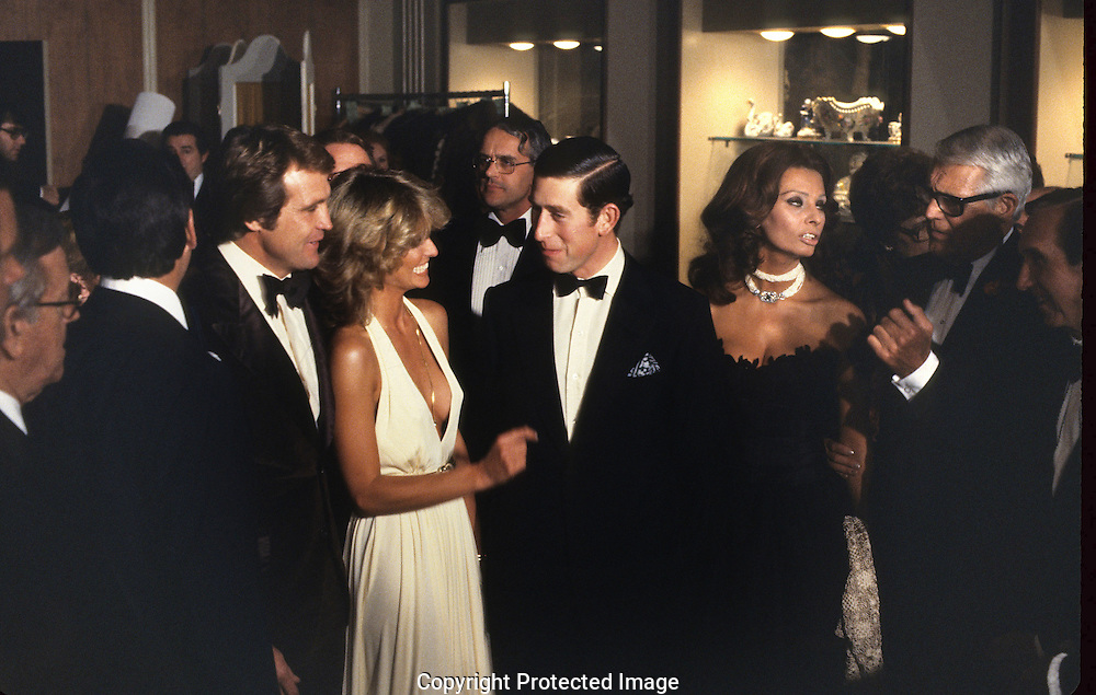 Prince Charles chats with Farrah Fawcett Majors, Lee Majors, Sophia Loren and Cary Grant at a reception in Hollywood in 1977..Photograph by Dennis Brack bb 21