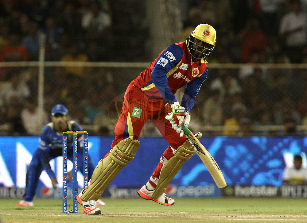 Royal Challengers Bangalore player Chris Gayle plays a shot during match 22 of the Pepsi IPL 2015 (Indian Premier League) between The Rajasthan Royals and The Royal Challengers Bangalore held at the Sardar Patel Stadium in Ahmedabad , India on the 24th April 2015.<br /> <br /> Photo by:  Vipin Pawar / SPORTZPICS / IPL
