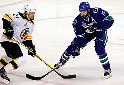 June 1, 2011; Vancouver, BC, CANADA; Vancouver Canucks center Ryan Kesler (17) waits for a pass against Boston Bruins defenseman Andrew Ference (21) during game one of the 2011 Stanley Cup Finals at Rogers Arena. The Canucks won 1-0. Mandatory Credit: Jason O. Watson / US PRESSWIRE