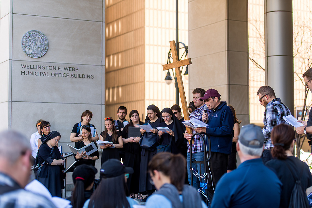 DENVER, CO - APRIL 19: A Way of the Cross procession put on by Communion and Liberation takes places in downtown Denver on April 19, 2019, in Denver, Colorado. (Photo by Daniel Petty/Denver Catholic)