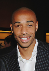Former Arsenal and France striker Thierry Henry has announced his retirement from football after a trophy-laden 20-year career to take up a media role. The 1998 World Cup winner, 37, left New York Red Bulls this month but there was speculation he might choose to play on at another club. File photo : French soccer superstar Thierry Henry poses during the opening party for Tommy Hilfiger's flagship store in Paris, France, on October 18, 2006. The store, located on the famous 'rue St Honore' in the heart of Paris, is Tommy's first in France. The opening celebration started with a cocktail at the store and was followed by a surprise concert by Lenny Kravitz held at the 'Ecole des Beaux-Arts'. Photo by Nicolas Khayat/ABACAPRESS.COM  Henry Thierry Tommy Hilfiger (marque) Hors-Sport Hors Sport Seule Seul Seuls Seules Alone Soiree Party Souriantes Souriants Souriant Souriante Sourires Heureuse Heureux Sourire Smiling Smile Smiles France Frankreich Ile-de-France Paris Headshot Portraits Portrait Headshots Head Shot Head Shots  | 108140_26 Paris France