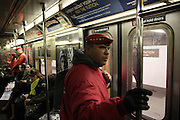 "Manhattan, N.Y. November 15, 2013. Ben ""E.Q."" Garcia scans the subway platform during a Guardian Angels subway patrol. 11/15/2013. Photo by Paul McCaffrey/NYCity Photo Wire"