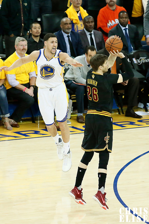 12 June 2017: Cleveland Cavaliers guard Kyle Korver (26) takes a jump shot past Golden State Warriors guard Klay Thompson (11) during the Golden State Warriors 129-120 victory over the Cleveland Cavaliers, in game 5 of the 2017 NBA Finals, at the Oracle Arena, Oakland, California, USA.