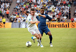 James MILNER - Patrice EVRA during the 1-1 draw in the Group D Match Against France AT The Euro 2012 Football Championships in Donetsk, Ukraine, June 11 2012. Photo By Imago/i-Images