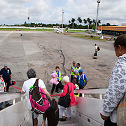 Passengers disembark an American Airlines flight from Miami at Jose Marti airport in Havana.<br /> Photography by Jose More