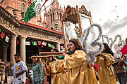 Woman dressed as angels carry the statue of Saint Michael from the Parroquia de San Miguel Arcangel church at the start of the week long fiesta of the patron saint September 21, 2017 in San Miguel de Allende, Mexico.