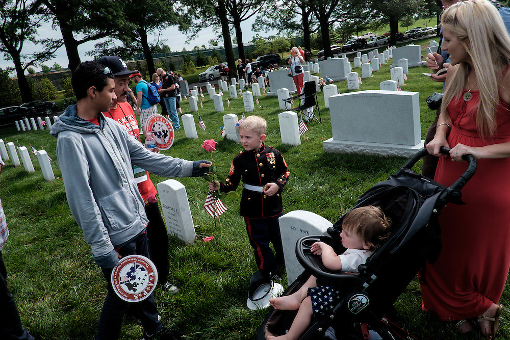 On Memorial Day, Christian Jacobs, 4, of Hertford, NC, walks past the headstone of his father, Marine Sgt. Christopher Jacobs, in Section 60 at Arlington National Cemetery in Arlington, Virginia, USA, on 30 May 2016.