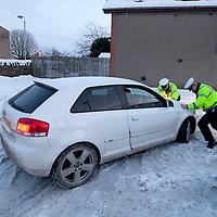 Perthshire Snow & Ice....05.01.10<br /> Tayside Police constables Brian Anderson and Keith Sutherland help to push a motorist out of the snow and ice in Auchterarder this morning<br /> Picture by Graeme Hart.<br /> Copyright Perthshire Picture Agency<br /> Tel: 01738 623350  Mobile: 07990 594431