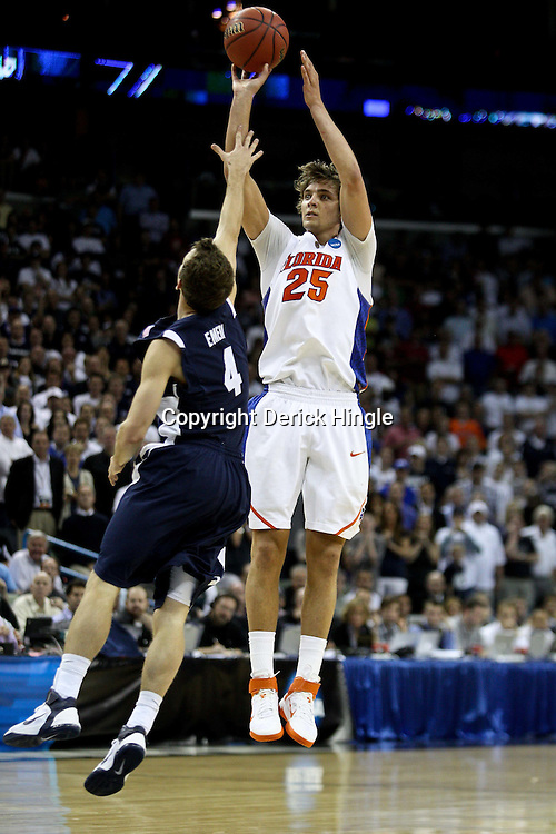 Mar 24, 2011; New Orleans, LA; Florida Gators forward Chandler Parsons (25) shoots over Brigham Young Cougars guard Jackson Emery (4) during the second half of the semifinals of the southeast regional of the 2011 NCAA men's basketball tournament at New Orleans Arena. Florida defeated BYU 83-74.   Mandatory Credit: Derick E. Hingle