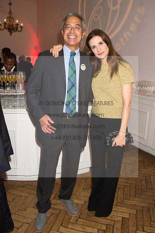 DR MITCH BESSER founder of mothers2mothers and LIVIA FIRTH at a gala dinner to celebrate 15 Years of mothers2mothers hosted by Annie Lennox held at One Marylebone, 1 Marylebone Road, London NW1on 3rd November 2015.