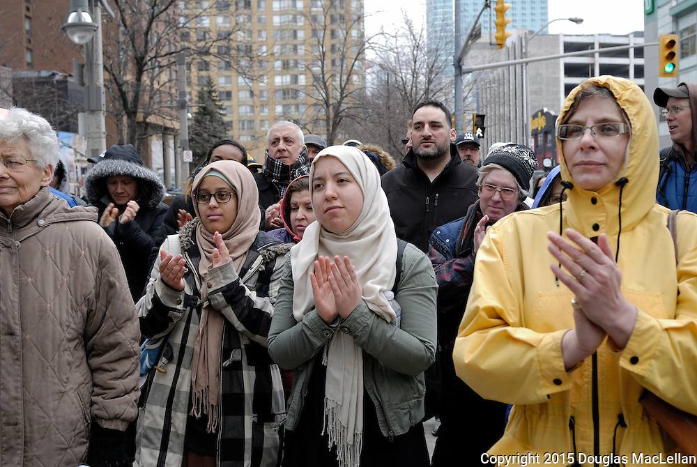 Windsor, Canada. 14th March 2015 --Ann Beer, a book store owner, Zeinab Ahmed, Widad Mezahi and Mireille Coral, a local activist (all in the front row) react to a speaker's comments during a demonstration against the new federal anti-terroirism law, bill C-51, in downtown Windsor, Ontario. -- About 150 people turn out for a demonstration in downtown Windsor, Ontario against Canada's proposed anti-terrorist law, bill C-51. The action was part of an estimated 45 other similar demonstrations across Canada.<br />