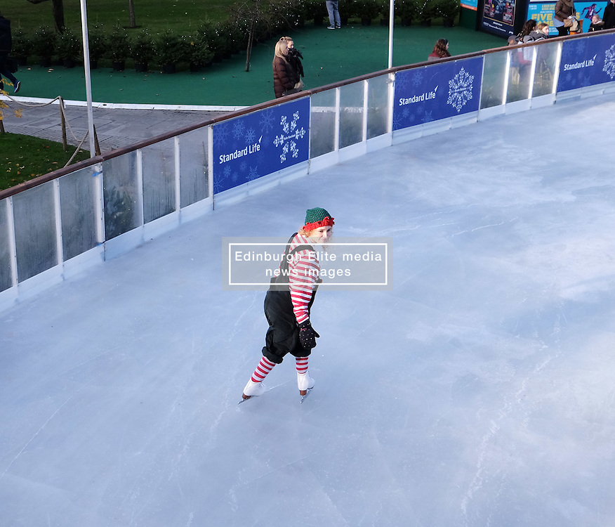 Edinburgh's Christmas 2016, Friday 18th November 2016<br /> <br /> The Edinburgh's Christmas Ice Rink in St Andrew's Square opened to the public today.<br /> <br /> A skating elf takes to the ice<br /> <br /> (c) Alex Todd | Edinburgh Elite media