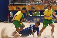 Football-FIFA Beach Soccer World Cup 2006 - Group A-BRA_JPN - Benjamin-Brazil- made a sand storm in front of Japanese defensel- Rio de Janeiro - Brazil 05/11/2006<br />Mandatory credit: FIFA/ Marco Antonio Rezende.