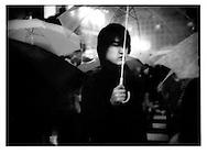 Under umbrella in nighttime rain, Hachiko Shibuya, Tokyo, Japan.