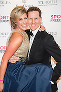 Julia Immonen, the charity organiser, and Brendan Cole,	Stictly Come Dancing - UK charity, Sport for Freedom (SFF), marks Anti-Slavery Day 2015 by hosting a charity Gala Dinner, supported by Aston Martin, on Thursday 15th October at Stamford Bridge, home of Chelsea Football Club. This inaugural event brought together people from the world of sport, entertainment, media, and business to unite behind a promise to tackle the issue of modern day human trafficking and slavery.  <br /> Hosted by Sky presenters Sarah-Jane Mee and Jim White, the Sport for Freedom Gala Dinner includes guests such as jockey AP McCoy OBE; Denise Lewis, former British Olympic Gold Medal winner; BBC Strictly star, Brendan Cole; Al Bangura, former Watford FC player and Sport for Freedom Ambassador who was trafficked from Africa to the UK at the age of just 14yrs old; Made in Chelsea star, Ollie Proudlock; ITV weather presenter, Lucy Verasamy; Sky Sports F1 presenter and SFF Ambassador, Natalie Pinkham; Premier League footballers Ryan Bertrand of Southampton FC and Troy Deeney of Watford FC and champion boxer, Anthony Joshua; and The UK's first independent Anti Slavery Commissioner, Kevin Hyland OBE, who highlighted the issues of modern day slavery that face the UK and world today. <br /> The evening concluded with chart topping music from 'Naughty Boy'. <br /> Sport for Freedom are also joining forces with the Premier League Academies for an international  'Football for Freedom' tournament with their U16's players that will also involve educating those taking part about the issues surrounding modern day slavery. The final will take place at Liverpool FC's Academy on Anti-Slavery Day, 18th October.