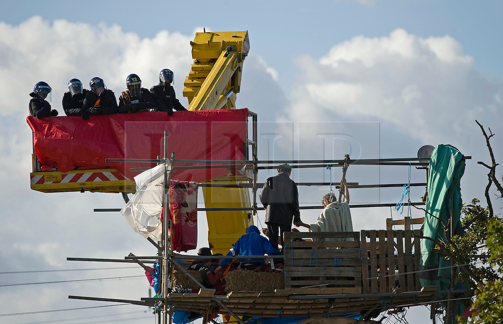 © Licensed to London News Pictures. 19/10/2011. Crays Hill, UK. Police attempt to remove activists from a structure blocking the entrance to Dale Farm travellers site. Residents at Dale Farm, the UK's largest illegal traveller site being evicted today (19/10/2011) following a long dispute with Basildon Council . Travellers and activist had barricaded themselves in to the site in an attempt to prevent their eviction. Photo credit: Ben Cawthra/LNP
