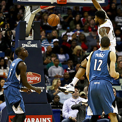 Feb 27, 2016; New Orleans, LA, USA; New Orleans Pelicans forward Alonzo Gee (15) dunks over Minnesota Timberwolves forward Tayshaun Prince (12) during the first half of a game at  the Smoothie King Center. Mandatory Credit: Derick E. Hingle-USA TODAY Sports