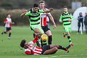 Forest Green Rovers Omar Bugiel(11) rides a challenge during the The Central League match between Cheltenham Town Reserves and Forest Green Rovers Reserves at The Energy Check Training Ground, Cheltenham, United Kingdom on 28 November 2017. Photo by Shane Healey.