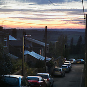 Sun setting in Pont Valley ahead of the the day of protest against the mining company Banks outside Dipton in Pont Valley, County Durham, 4 May 2018. Locals have fought the open cast coal mine for thirty years and three times the local council rejected planning permissions but central government has overruled that decision and the company Banks was granted the license and rights to extract coal in early 2018. Locals have teamed up with climate campaigners and together they try to prevent the mining from going ahead. The mining will have huge implications on the local environment and further coal extraction runs agains the Paris climate agreement. A rare species of crested newt live on the land planned for mining and protectors are trying to stop the mine to save the newt.