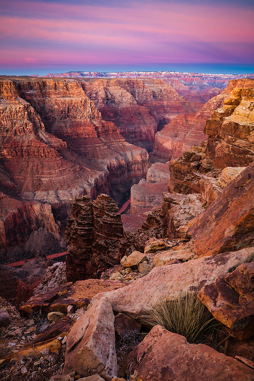 Looking down the Little Colorado River gorge towards the snow covered North Rim of the Grand Canyon.