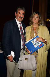 Actor JOHN CHALLIS and his wife CAROLINE at a private view and auction of a collection of paintings, drawings and doodles by well known personalities to mark the Book launch of Ackroyd's Ark in Christie's, 8 King Street, St.James's, London on 20th September 2004 in aid of Tusk Trust.<br /><br />NON EXCLUSIVE - WORLD RIGHTS