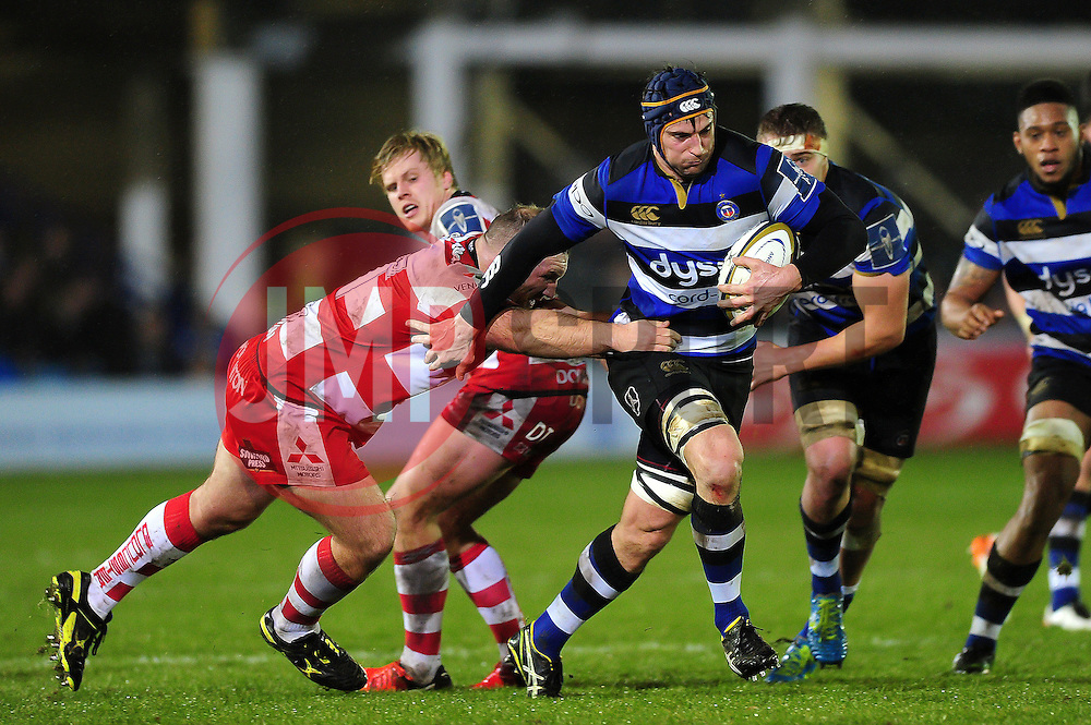 Paul Grant of Bath Rugby takes on the Gloucester Rugby defence - Mandatory byline: Patrick Khachfe/JMP - 07966 386802 - 27/01/2017 - RUGBY UNION - The Recreation Ground - Bath, England - Bath Rugby v Gloucester Rugby - Anglo-Welsh Cup.