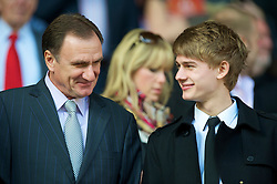 LIVERPOOL, ENGLAND - Sunday, April 11, 2010: Former Liverpool player Phil Thompson and his son watches Liverpool take on Fulham during the Premiership match at Anfield. (Photo by: David Rawcliffe/Propaganda)