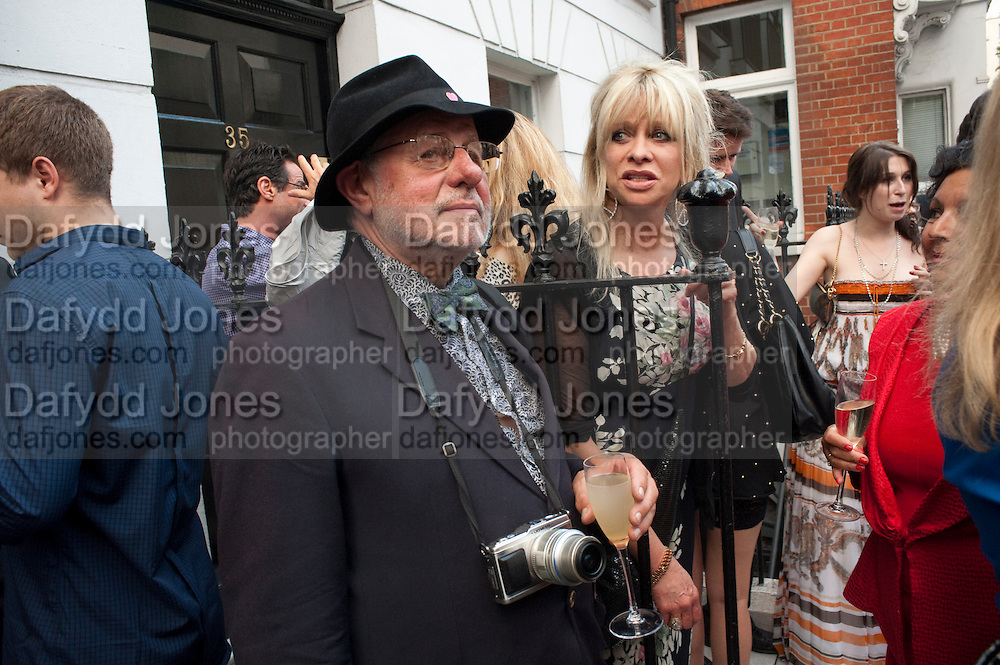 BARRY LATEGAN; JO WOOD,  Private view and Summer party for Scream Now. An exhibitio of new work by gallery artists. Bruce French,, Derrick Santini, Greg Miller, Malgosia Stepnik, Pakpoom Silaphan, Petroc Sesti, Russell Young. Scream. Bruton st. London. 4 August 2011. <br /> <br />  , -DO NOT ARCHIVE-© Copyright Photograph by Dafydd Jones. 248 Clapham Rd. London SW9 0PZ. Tel 0207 820 0771. www.dafjones.com.