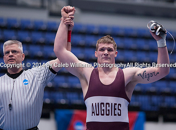 NCAA Division III Wrestling National Championships<br /> Session III<br /> <br /> CEDAR RAPIDS, Iowa (Feb. 14, 2014) -- Chad Johnson Celebrates his third place finish at 285 pounds during Session III of the 2014 Wrestling National Championships at the US Cellular Center in Cedar Rapids, Iowa. Johnson defeated Zachery Roseberry (Delaware Valley by 7-3. It was Johnson's fourth All American Honor to close his season at 32-2, his last three seasons at 108-4 and his career at 140-15.