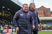 AFC Wimbledon manager Wally Downes smiling during the EFL Sky Bet League 1 match between Southend United and AFC Wimbledon at Roots Hall, Southend, England on 16 March 2019.