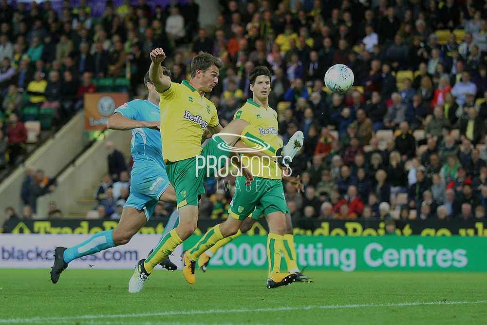 Norwich City's Christoph Zimmermann clears the danger during the EFL Sky Bet Championship match between Norwich City and Burton Albion at Carrow Road, Norwich, England on 12 September 2017. Photo by John Potts.