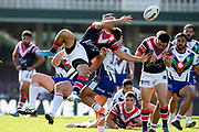 Lachlan Burr and James Tedesco  contest a kick. Sydney Roosters v Vodafone Warriors. NRL Rugby League. Sydney Cricket Ground, Sydney, Australia. 18th August 2019. Copyright Photo: David Neilson / www.photosport.nz