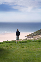 Man standing alone on a cliff top,