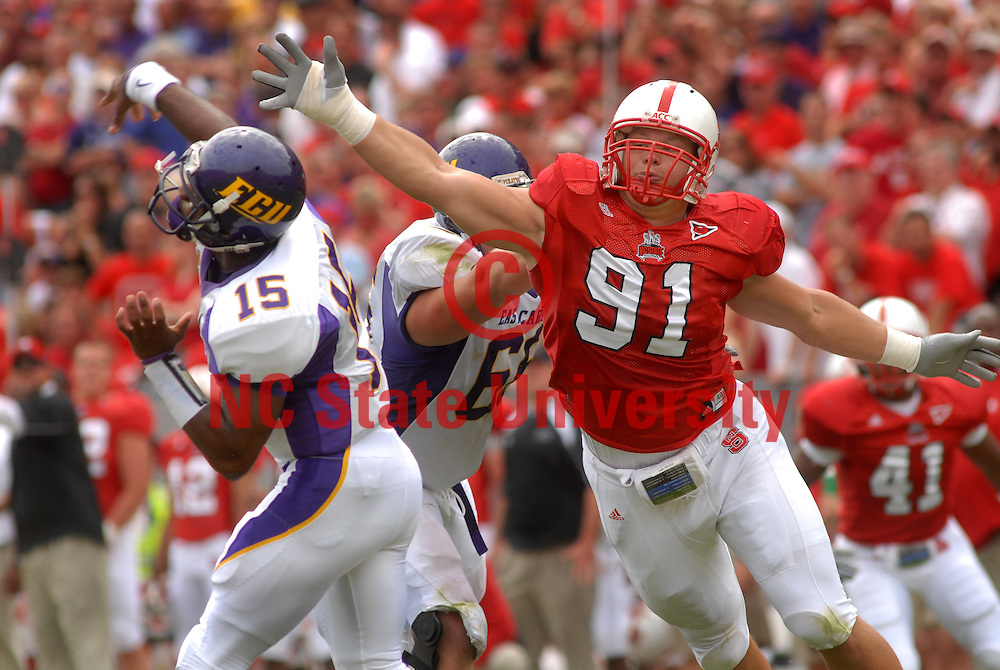 The Pack's Markus Kuhn reaches for ECU quarterback. PHOTO BY ROGER WINSTEAD