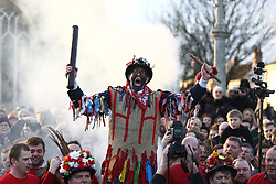 © Licensed to London News Pictures. 06/01/2018. Haxey, UK. Picture shows the fool making his speech that marks the start of The Haxey Hood game that is taking place today in the village of Haxey in Lincolnshire. The Haxey Hood is a traditional event that takes place every January & is played by teams from four pubs, the Carpenters Arms, the Duke William Hotel, The Loco & The kings Arms. The game is like a large rugby scrum called the 'sway' which pushes a leather tube called the 'hood' to one of the four pubs, the game is won when a team gets the hood to the front step of the pub & it is touched by the landlord. Photo credit: Andrew McCaren/LNP