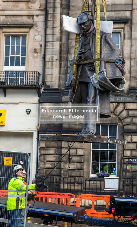 The sculpture of Sherlock Holmes by former pop-artist Gerald Laing is being moved from it's home on Picardy Place, yards from the birth place of Sir Arthur Conan Doyle.<br /> <br /> The move of the sculpture is to accommodate road and tram works that are taking place in Edinburgh. The statue will be moved to Nairn at  Black Isle Bronze Ltd by the artists son, Farquhar Laing where it will stay for two years until it returns to Edinburgh.<br /> <br /> Pictured: The Sherlock Holmes statue mid-air