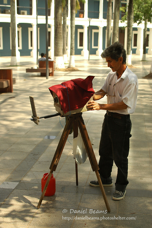 Old film photographer on the plaza of Santa Cruz, Bolivia
