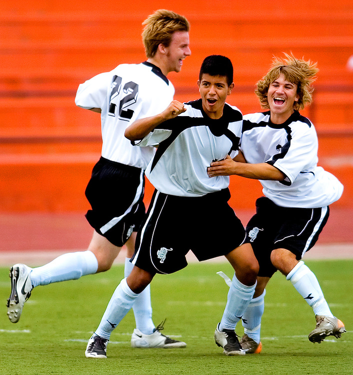 082507      Brian Leddy.Micah Gjeltema (22), Edgar Maldonado (16) and Tylor Sanchez (3) celebrate a goal during Saturday's matchup against Los Lunas. Despite the boys excitement, the team went on to lose 4-3.