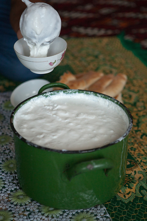Camel's milk mixed with well water, being poured into a bowl for eating with bread, Turkmenistan