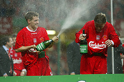 CARDIFF, WALES - Sunday, March 2, 2003: Liverpool's Michael Owen showers team-mate Vladimir Smicer with champagne as they celebrate beating Manchester United 2-0 during the Football League Cup Final at the Millennium Stadium. (Pic by David Rawcliffe/Propaganda)