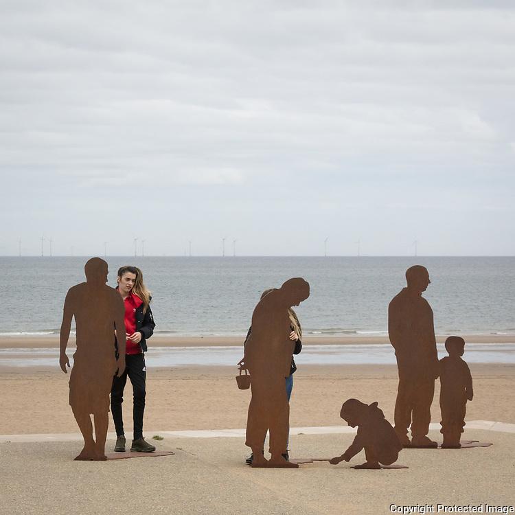 On The Beach sculpture by Freshwest, Colwyn Bay, Conwy.