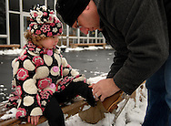 25 DEC. 2010 -- ST. LOUIS --   Howard Rosen (right) helps his 3-year-old daughter Emily Rosen lace her skates after a Christmas Day skating session at the Steinberg Skating Rink in Forest Park in St. Louis Saturday, Dec. 25, 2010. The Rosen family, which includes mom Marissa Rosen and Joshua Rosen, 5, are from Olivette, Mo. Image © copyright 2010 by Sid Hastings.