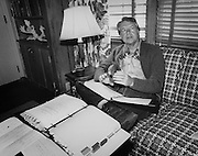 President Jimmy Carter works through briefing books while on vacation at Georgia's Sea Island.