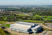 Nederland, Gelderland, Gemeente Arnhem, 30-09-2015; Arnhem-Zuid. Gelredome, overdekt voetbalstadion in de wijk Elden met Vitesse als thuisclub. Het stadion wordt ook gebruikt voor concerten en evenementen. Het multifunctionele superstadion heeft niet alleen een verschuifbaar dak maar ook een verplaastbaar grasveld, het voetbaldveld krijgt op deze wijze voldoende zonlicht. De betonnen vloer binnen kan gebruikt worden voor manifestaties e.d. zonder dat het gras beschadigd.<br /> Gelredome, covered football stadium in the district Elden with Vitesse as home club. The stadium is also used for concerts and events. The multipurpose super stadium has a moveable roof and a movable field, this way the football field gets sufficient sunlight. The concrete floor inside can be used for events without the grass being damaged.<br /> luchtfoto (toeslag op standard tarieven);<br /> aerial photo (additional fee required);<br /> copyright foto/photo Siebe Swart
