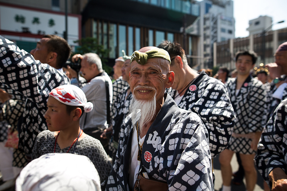 TOKYO, JAPAN - MAY 21: A man smile as he participate in the 'mikoshi' (portable shrines) parade during the Sanja Festival in Asakusa, Tokyo on May 21, 2017. These mikoshi is carried in the streets of Asakusa to bring luck, blessings and prosperity to the area and its inhabitants. (Photo: Richard Atrero de Guzman/NUR Photo)